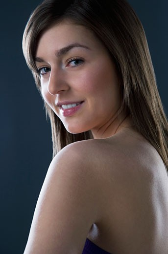 Stock Photo: 1889R-38364 Young woman with a bare shoulder
