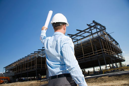 Architect overlooking building site : Stock Photo