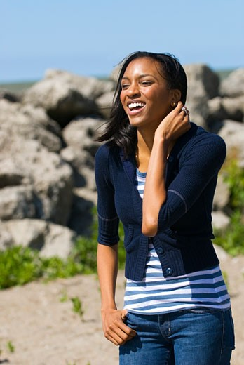 Stock Photo: 1889R-39494 Woman laughing at beach