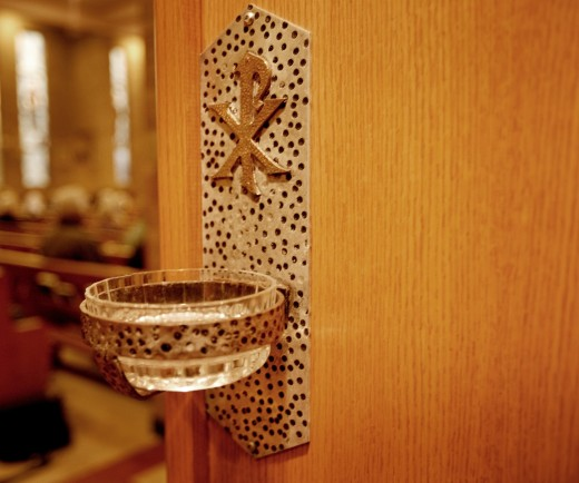 Stock Photo: 1889R-3995 Bowl of holy water upon entrance door of Catholic church