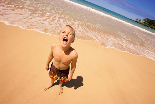 Stock Photo: 1889R-4110 Young boy crying on beach