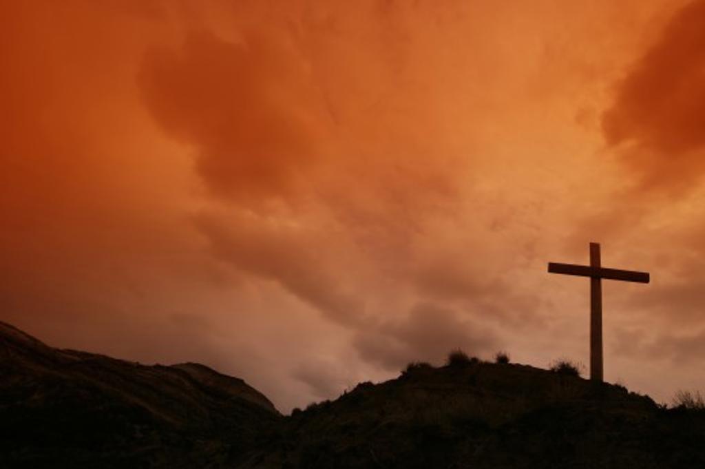 Cross on hillside : Stock Photo