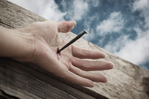 Stock Photo: 1889R-4366 Nail through hand on cross
