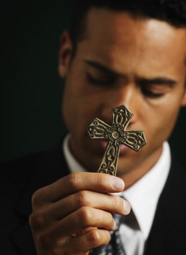 Stock Photo: 1889R-4445 Businessman holding out a cross