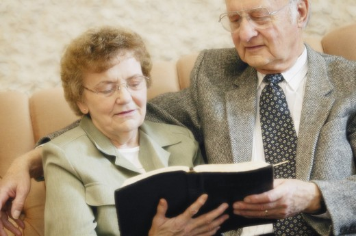 Senior couple reading bible : Stock Photo