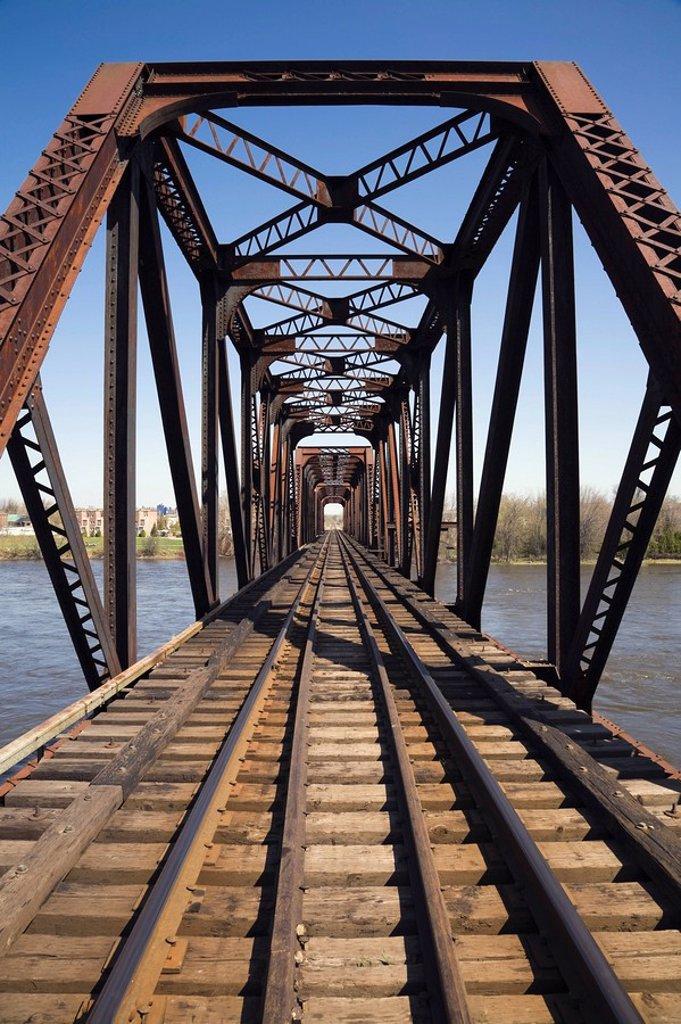 Railroad tracks through a steel railroad bridge, Laval, Quebec, Canada : Stock Photo