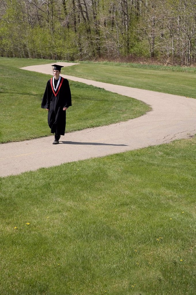 Stock Photo: 1889R-47130 Graduate walking a path