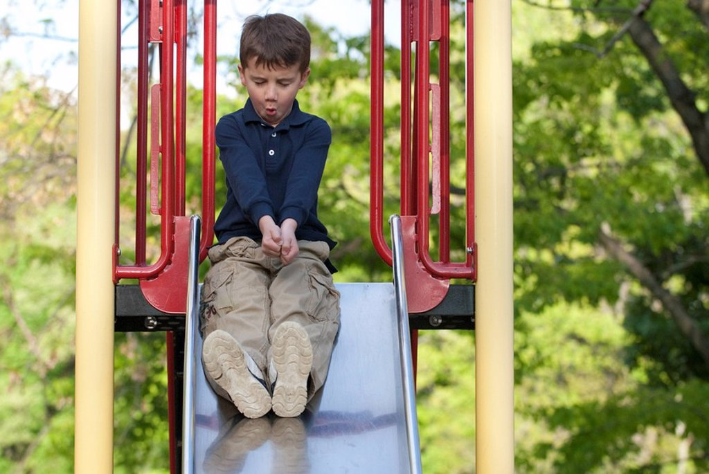 Boy on a slide : Stock Photo