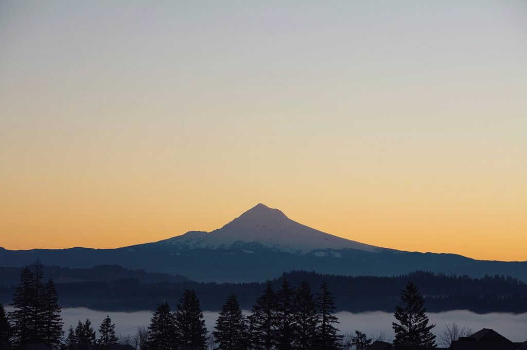 Stock Photo: 1889R-47444 Silhouette of mountain peak at sunrise