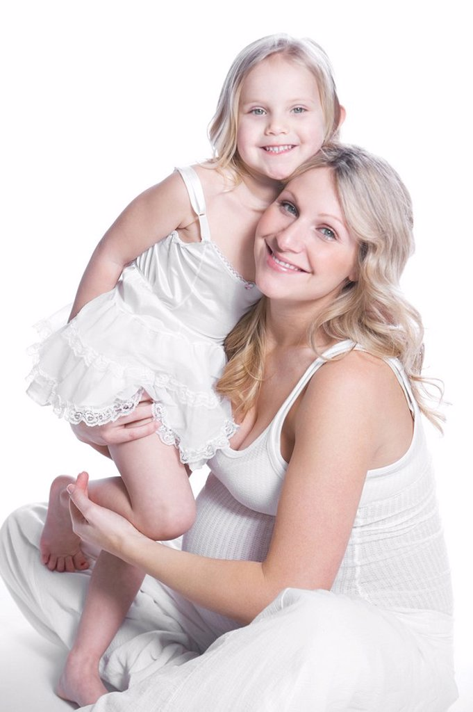 Pregnant woman with her daughter : Stock Photo