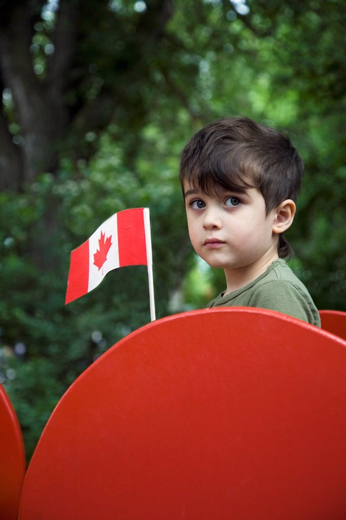 Boy holding a Canadian flag : Stock Photo