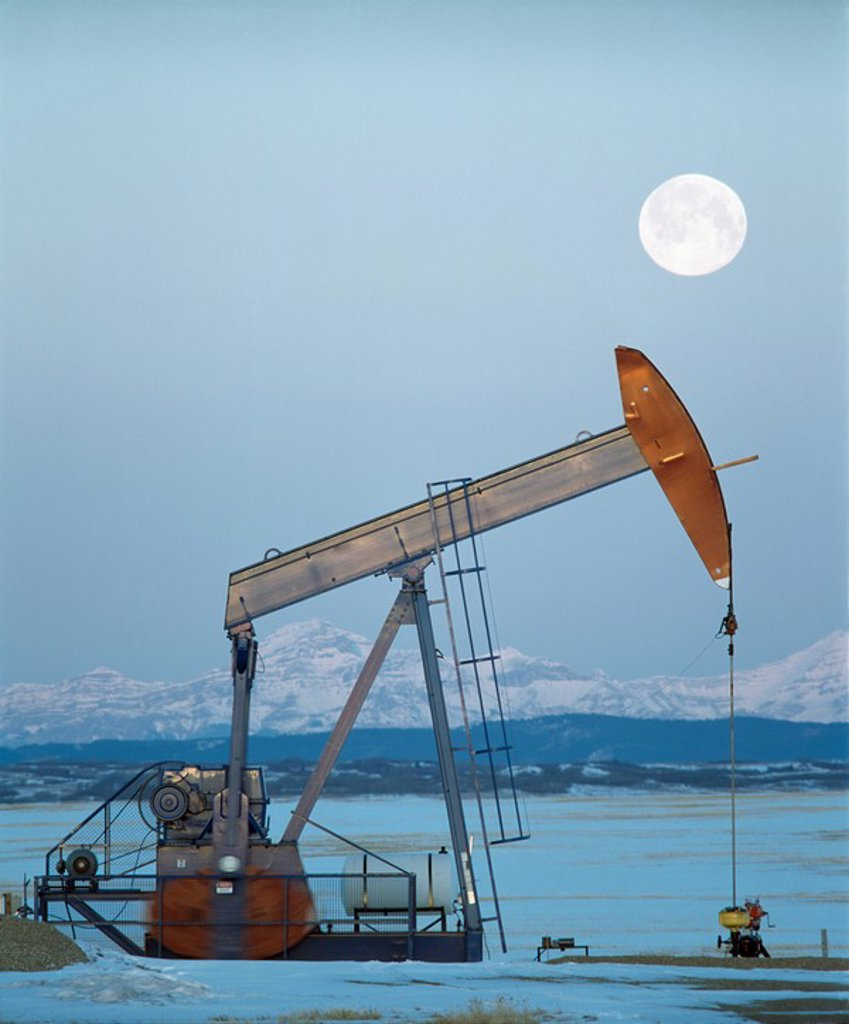 Stock Photo: 1889R-47694 Pump Jack and mountains, Alberta, Canada