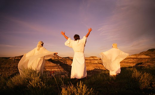 Stock Photo: 1889R-4773 Three angelic people on top of mountains