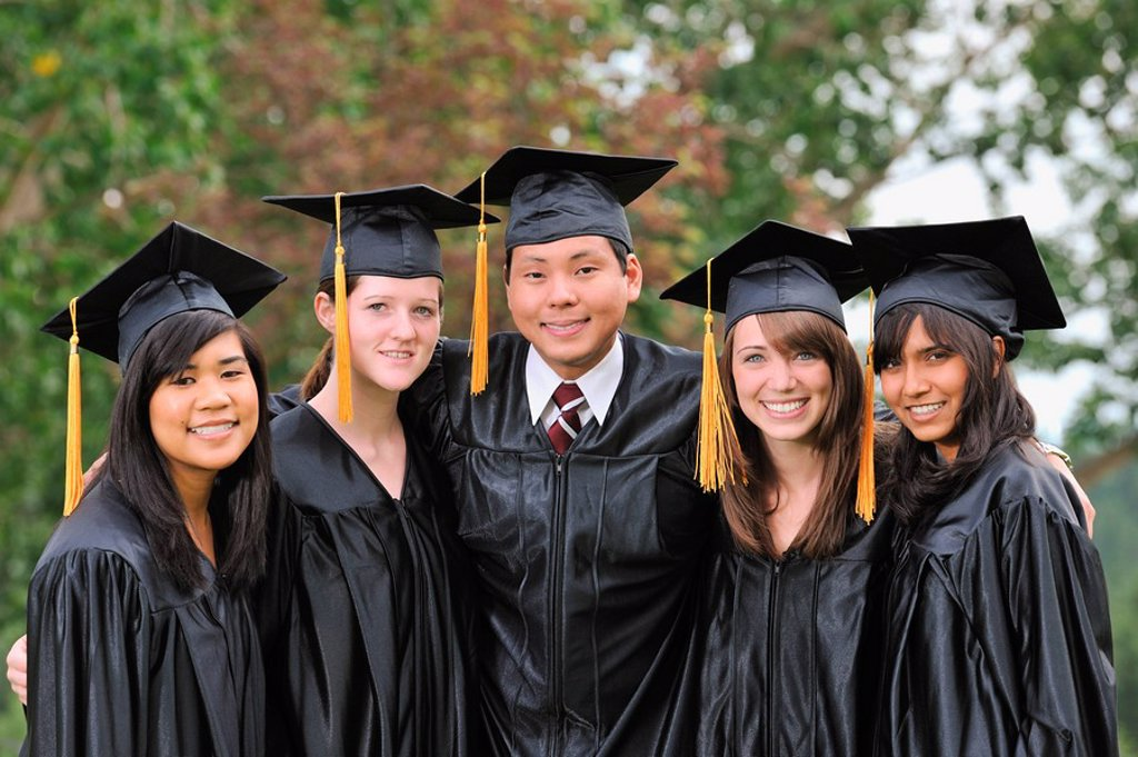 Stock Photo: 1889R-47786 Diverse university graduates outside together