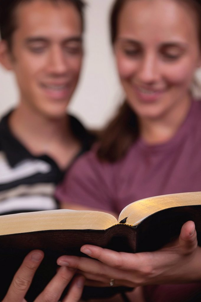 A couple reading the Bible together : Stock Photo