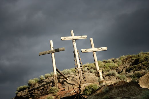 Stock Photo: 1889R-4814 Three crosses on a hill