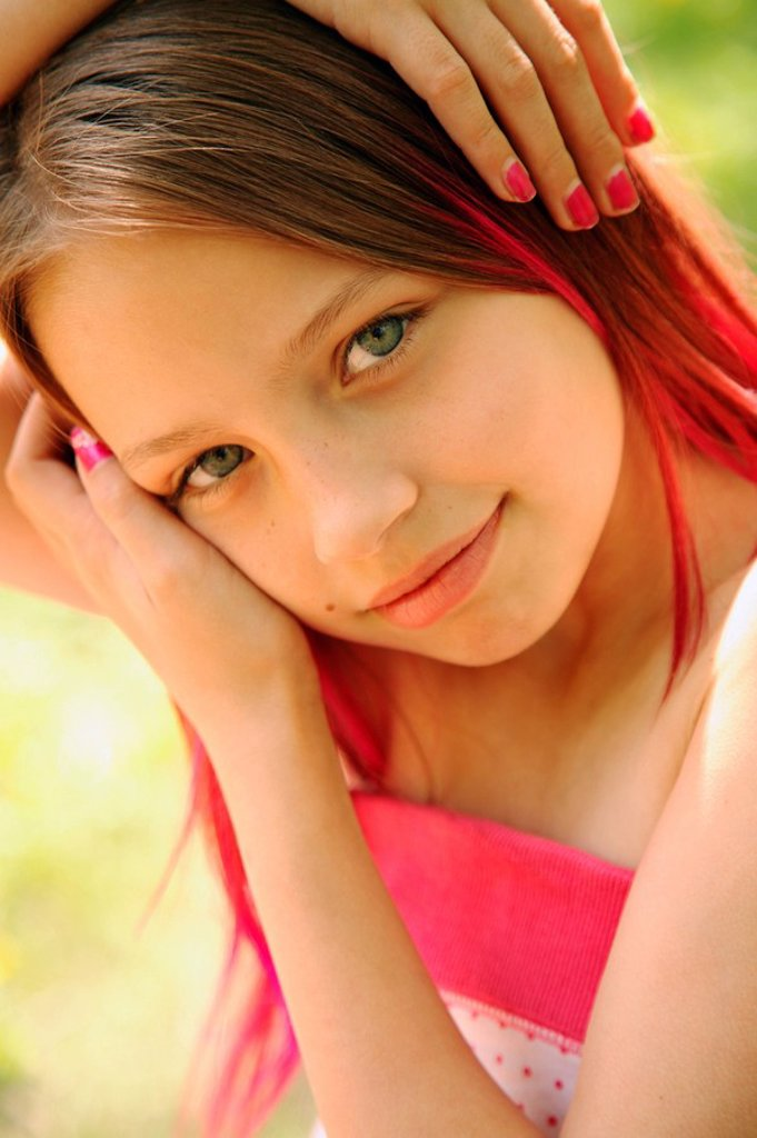 Stock Photo: 1889R-48243 Portrait of young girl wearing nail polish