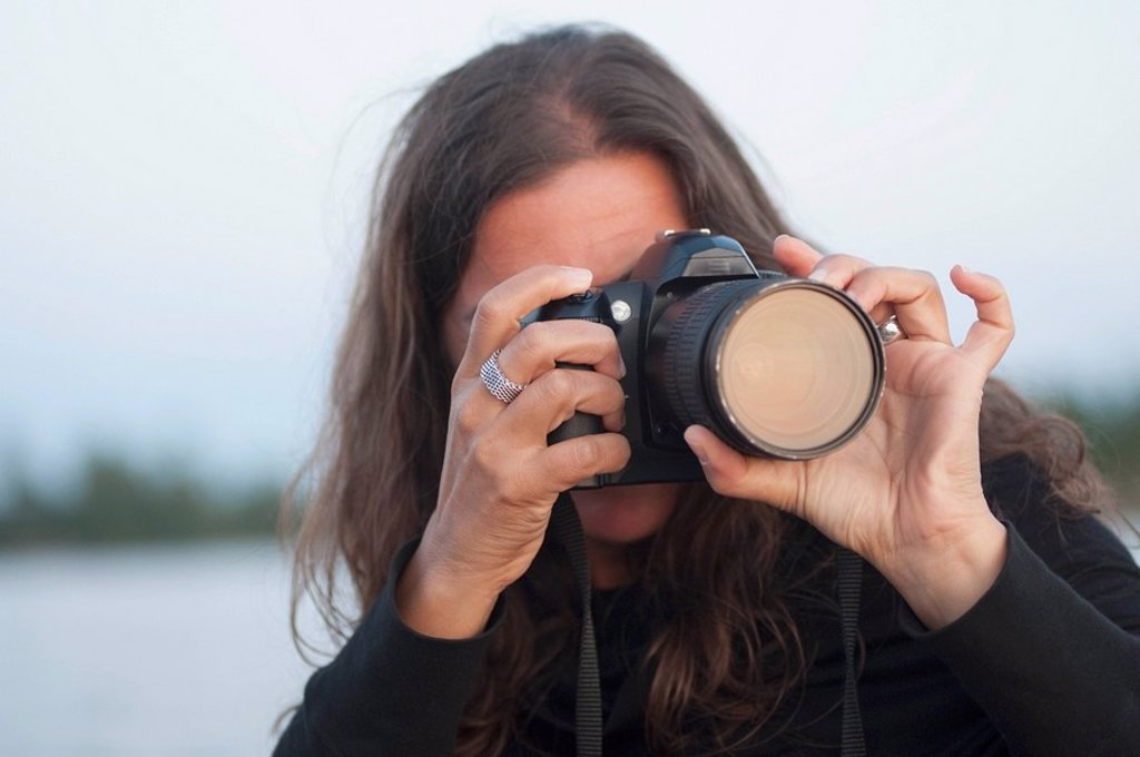 Woman taking a picture : Stock Photo