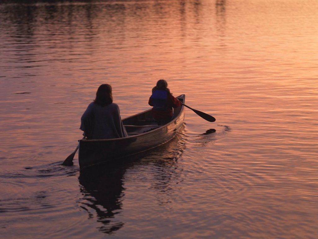 Two people in a canoe, Lake of the Woods, Ontario, Canada : Stock Photo