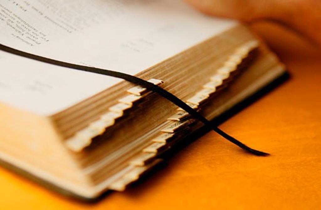 Stock Photo: 1889R-4919 An open Bible
