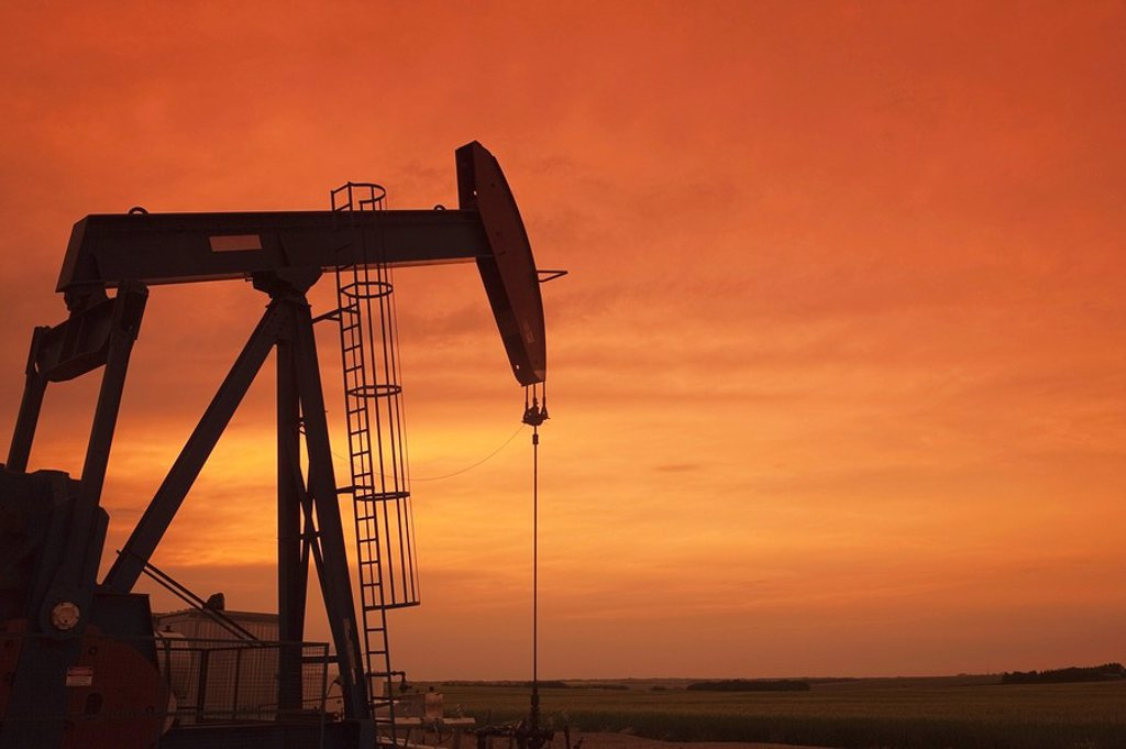 Alberta, Canada, Pumpjack at sunset : Stock Photo
