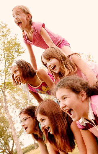A human pyramid of girls : Stock Photo