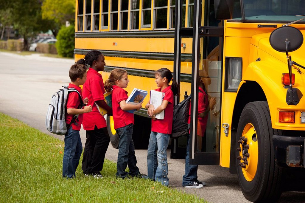 Stock Photo: 1889R-50577 students lined up to get on the school bus