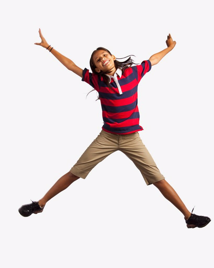 girl jumping with arms and legs outstretched : Stock Photo