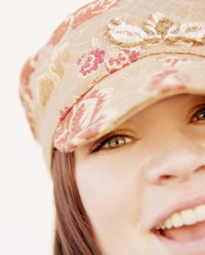 Smiling girl wearing a cap : Stock Photo
