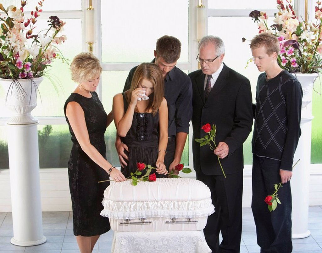 grieving family with an infant´s coffin : Stock Photo