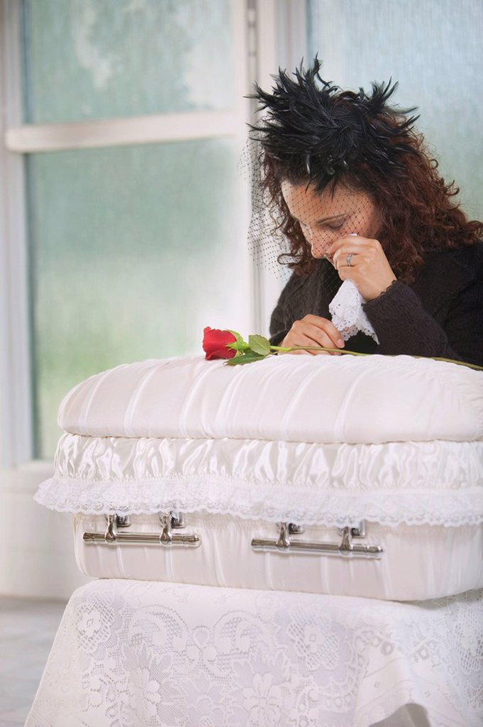 young mother grieving at an infant´s coffin : Stock Photo