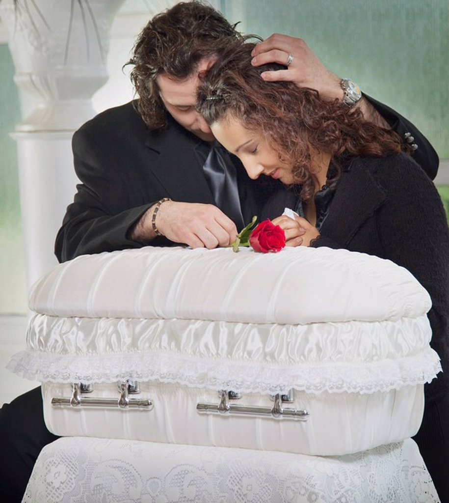 couple grieving at infant´s coffin : Stock Photo