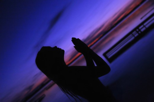 A woman in prayer : Stock Photo