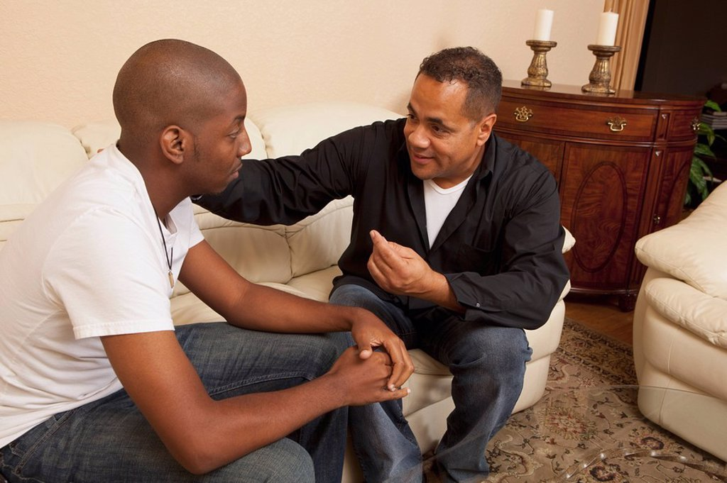 Stock Photo: 1889R-51414 two men talking together