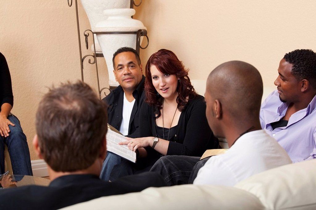 Stock Photo: 1889R-51550 a group of adults in a home bible study