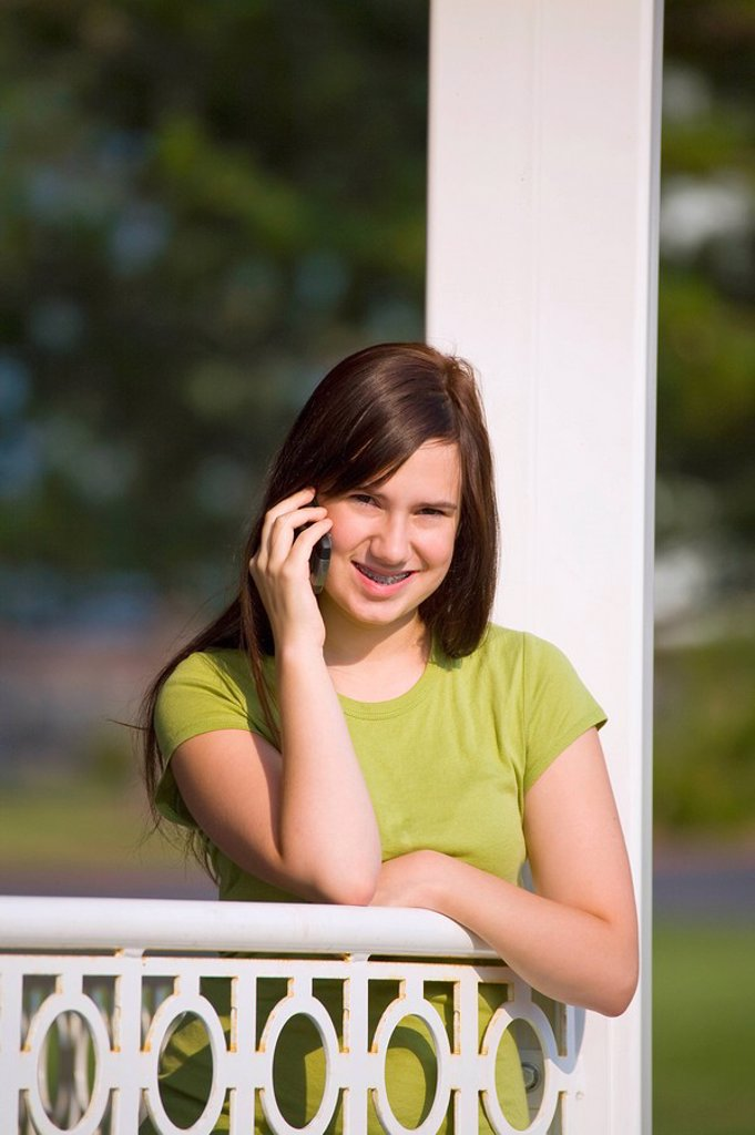 a girl talking on her cell phone : Stock Photo