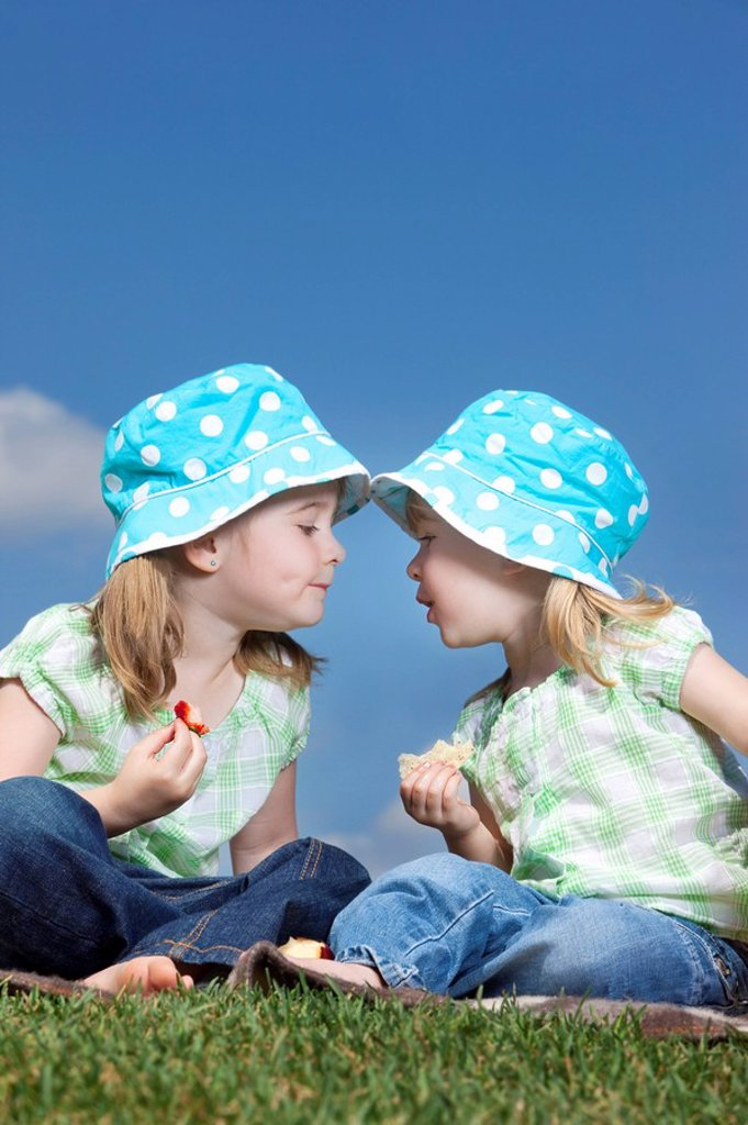 Stock Photo: 1889R-52244 two young girls with matching hats