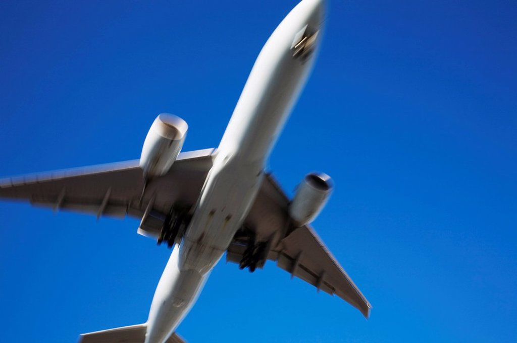 dorval, quebec, canada, underside view of a commercial jet airplane in flight with motion effect : Stock Photo