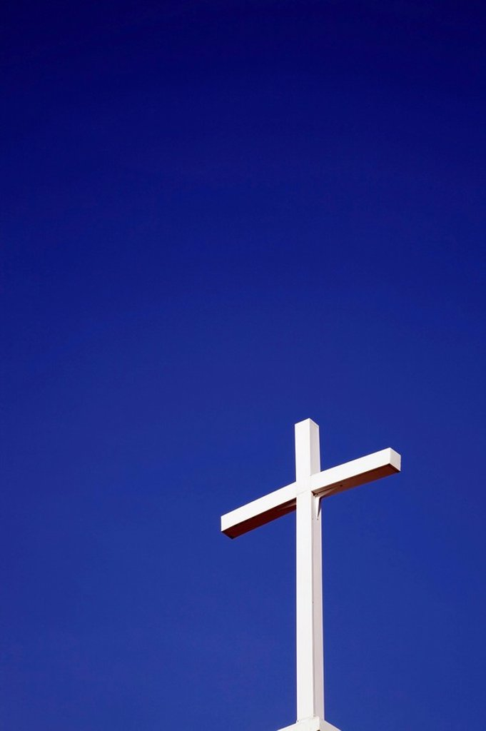 Stock Photo: 1889R-52800 white cross against a blue sky