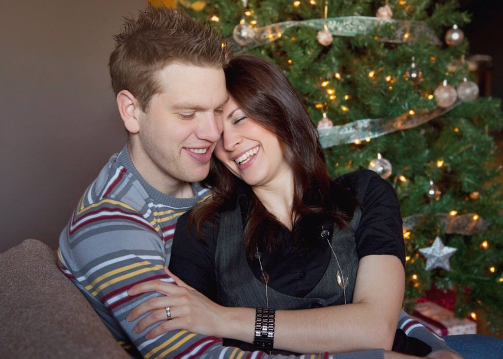 a couple by the christmas tree : Stock Photo