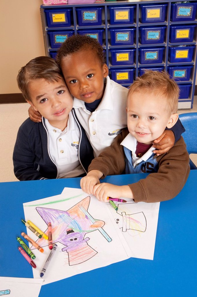 fort lauderdale, florida, united states of america, three young boys coloring at a table in a classroom : Stock Photo