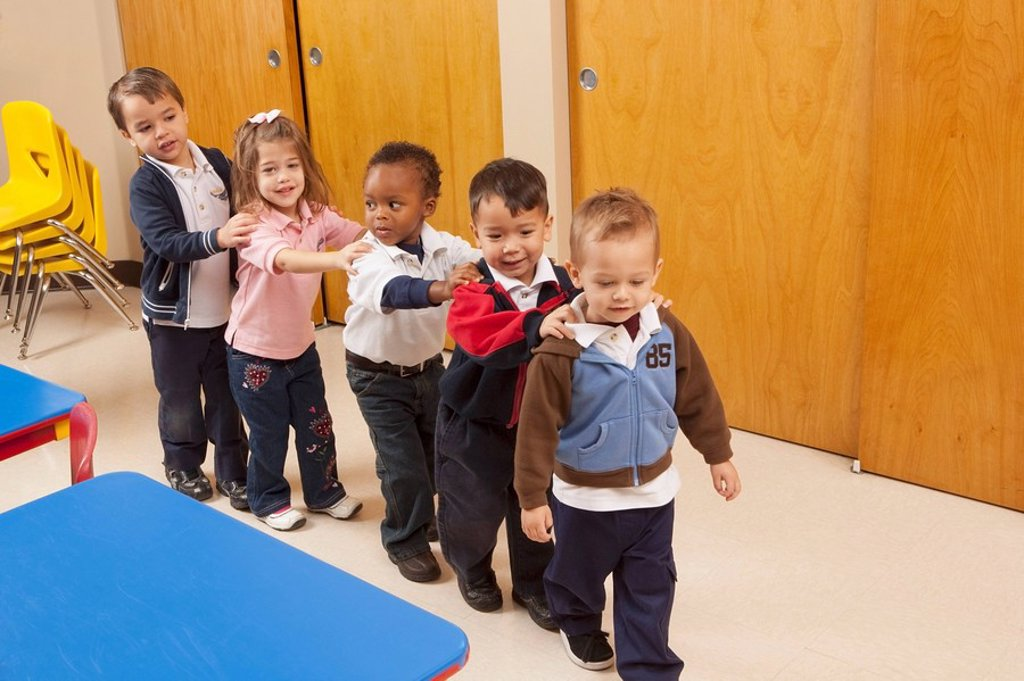 fort lauderdale, florida, united states of america, a line up of young children in a classroom : Stock Photo