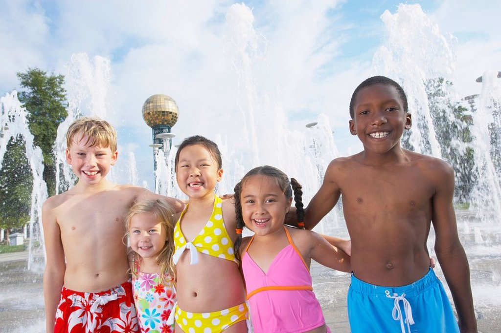 a group of children together at a water park : Stock Photo