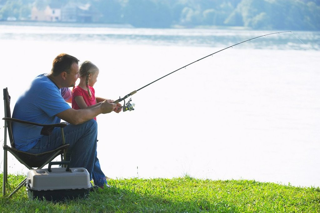 Stock Photo: 1889R-53429 a father and daughter fishing
