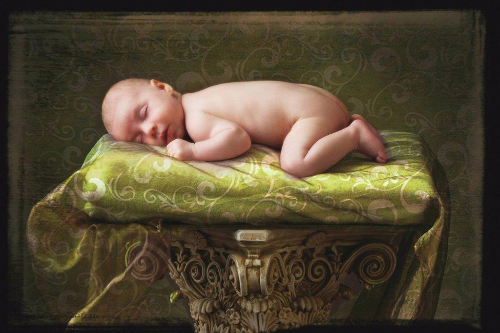 Stock Photo: 1889R-53520 a baby asleep on a pillar