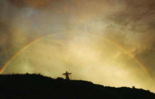 Stock Photo: 1889R-5367 Rainbow over angel on hill