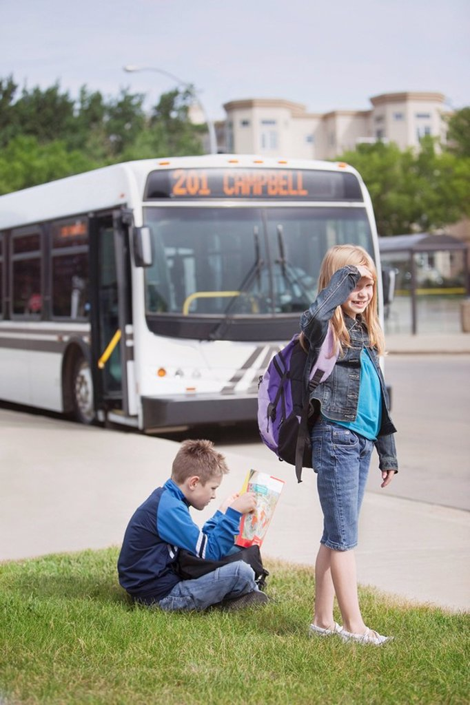 st. albert, alberta, canada, two children waiting for the city bus : Stock Photo