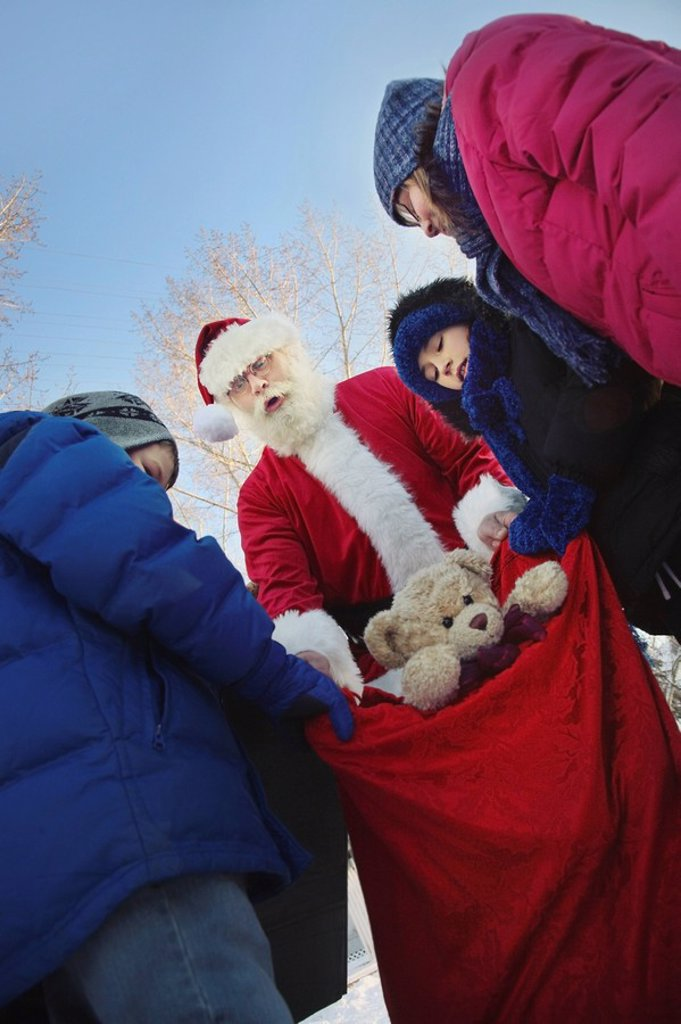 edmonton, alberta, canada, santa claus being caught with a sack full of toys : Stock Photo