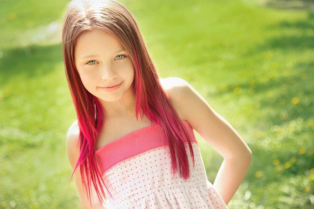 edmonton, alberta, canada, a girl with red tips at the end of her long hair : Stock Photo