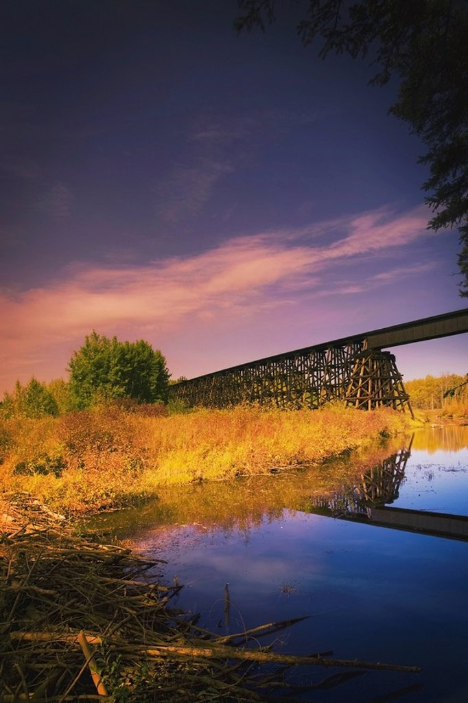 Alberta, Canada, A Train Trestle And A Beaver Dam In The River Below : Stock Photo